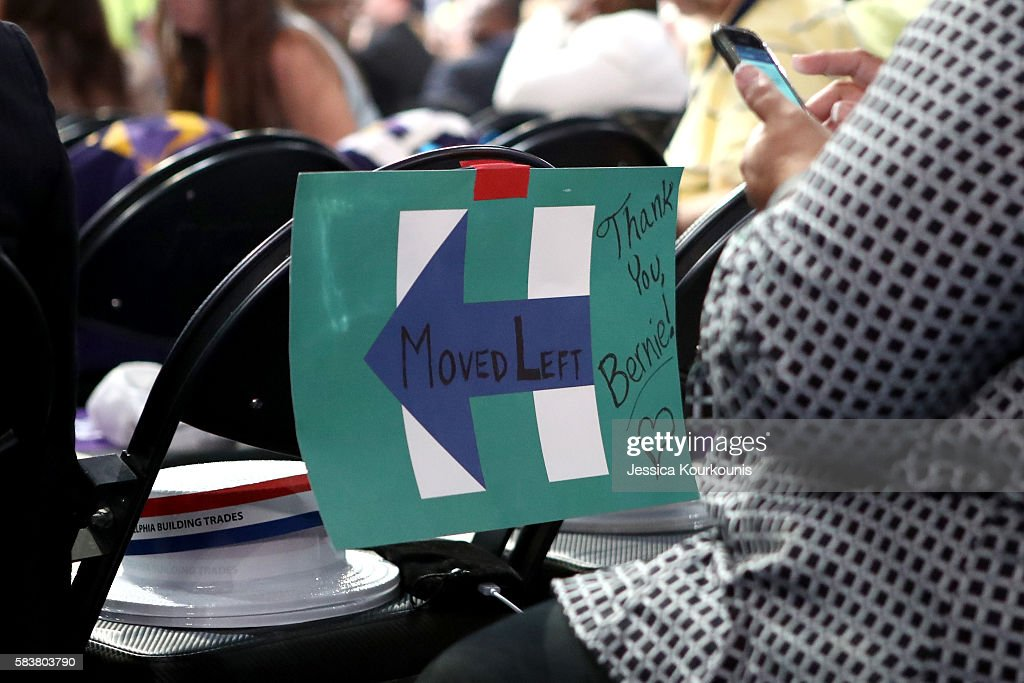"""A sign taped to the back of a chair reads """"Moved Left Thank you Bernie"""" on the third day of the Democratic National Convention at the Wells Fargo..."""