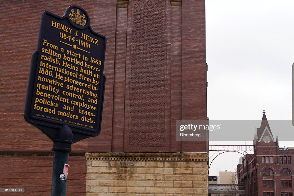 A sign tells the history of H.J. Heinz Co. founder Henry J. Heinz outside a production facility in Pittsburgh, Pennsylvania, U.S., on Thursday, Feb. 14, 2013. Warren Buffett's Berkshire Hathaway Inc. and Jorge Paulo Lemann's 3G Capital agreed to buy HJ Heinz Co. for about $23 billion, ending the independence of an iconic ketchup maker that traces its roots to the 1860s. Photographer: Kevin Lorenzi/Bloomberg via Getty Images