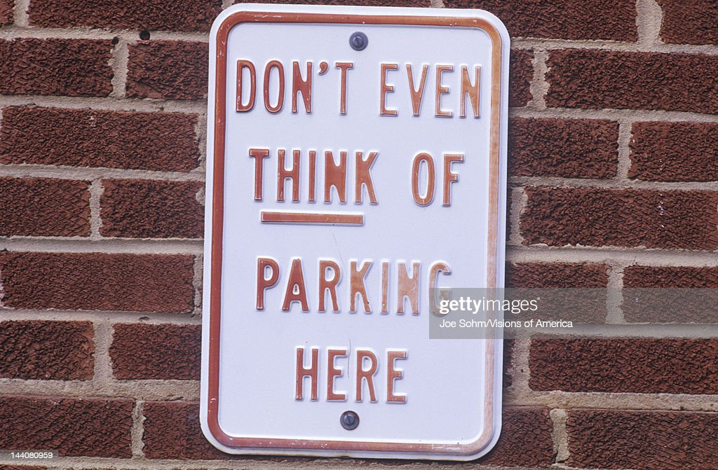 A sign that reads 'Don't even think of parking here'