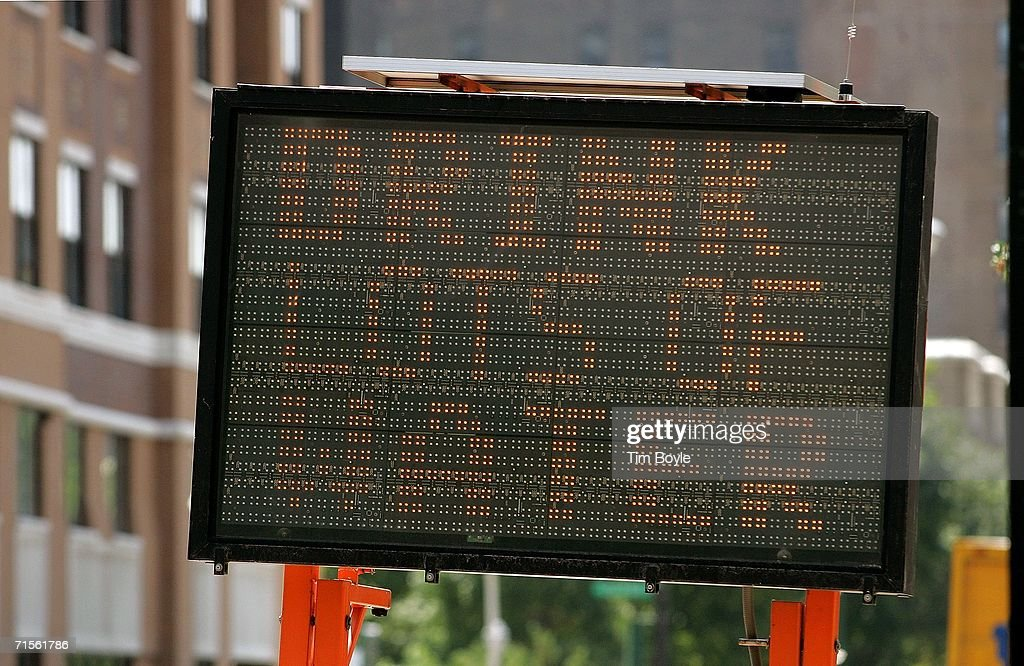 A sign that reads 'Drink Lots Of Water' warns drivers and pedestrians about the excessive heat August 1, 2006 in Chicago, Illinois. Hot and humid weather has hit parts of the Midwest with temperatures around the Chicago area in the high 90's and heat index readings nearing 105.