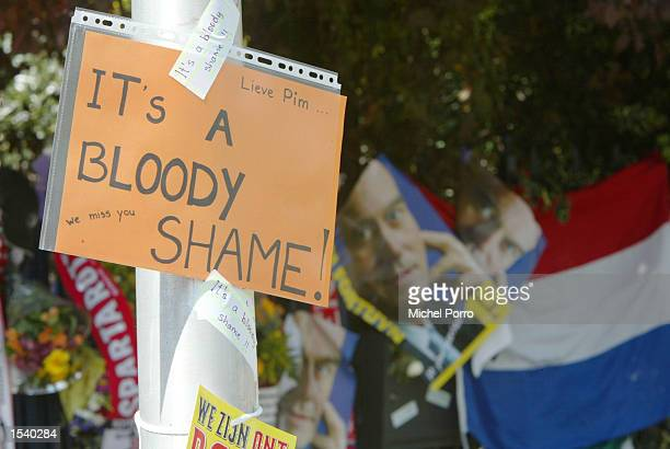 A sign that reads 'It's a bloody shame' hangs outside the house of the slain Dutch politician Pim Fortuyn May 7 2002 in Rotterdam Netherlands Fortuyn...