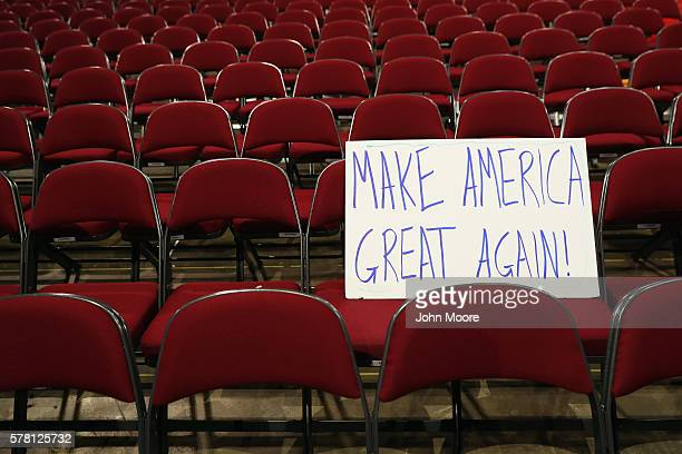 A sign that reads 'Make America Great Again' sits on the floor prior to the start of the third day of the Republican National Convention on July 20...