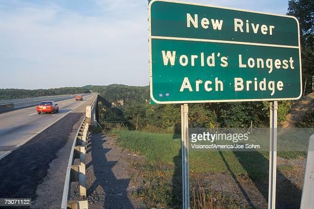 A sign that reads ?New River - World's Longest Arch Bridge?