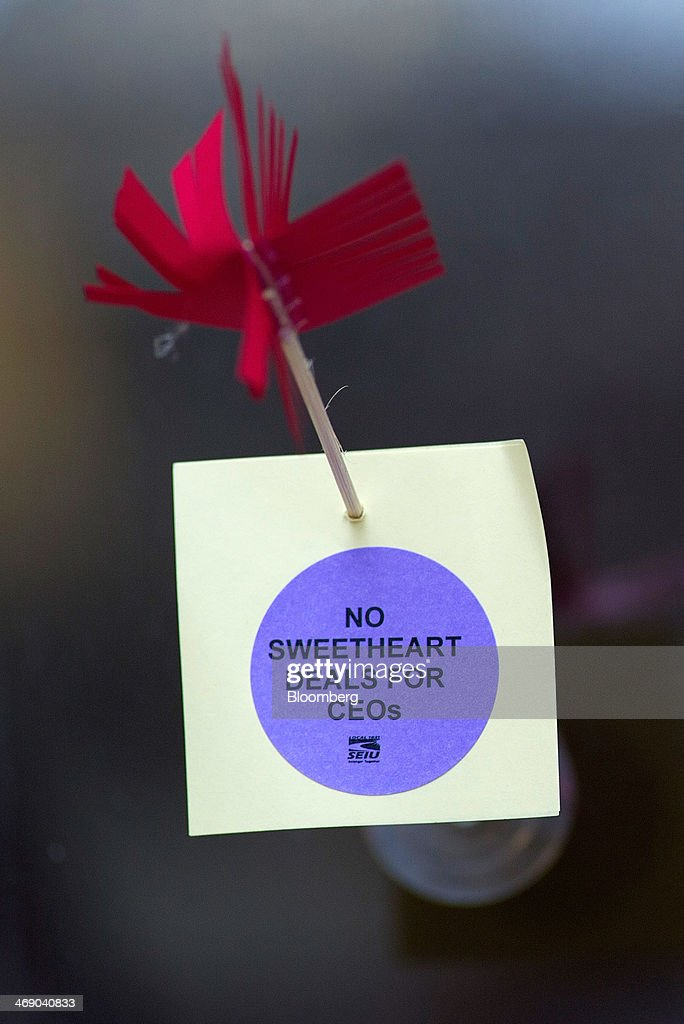 A sign that reads 'No Sweetheart Deals for CEOs' is displayed as members of the Service Employees International Union (SEIU) Local 1021 protest in front of Twitter Inc. headquarters in San Francisco, California, U.S., on Wednesday, Feb. 12, 2014. City workers represented by SEIU 1021 are participating in an affordable healthcare rally. Photographer: David Paul Morris/Bloomberg via Getty Images