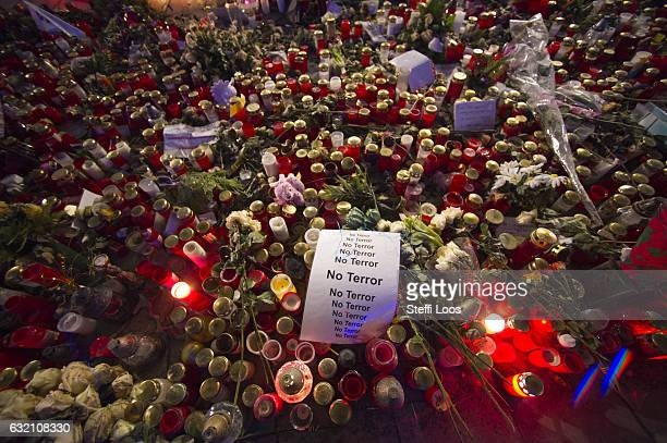 A sign that reads 'No Terror' lies on candles and flowers at a memorial for the Christmas market terror attack victims at Breitscheidplatz on January...