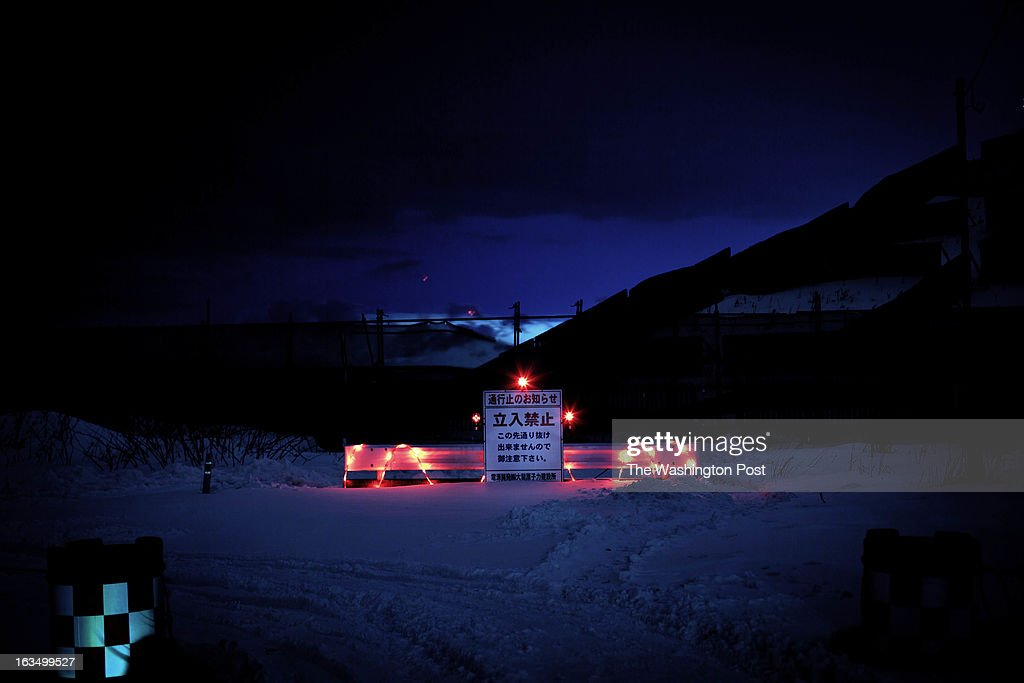 A sign that reads 'Road closed, No entry' blocks entrance to a road that leads to the Oma Nuclear Power Plant construction site.