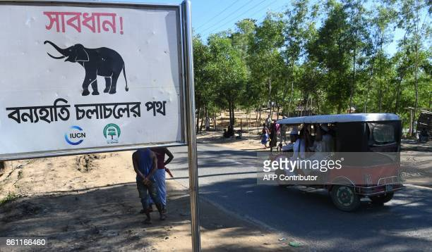 A sign that reads 'Warning Route for Wild Elephants' is pictured near Bangladesh's Balukhali camp for Rohingya refugees on October 14 2017 Wild...
