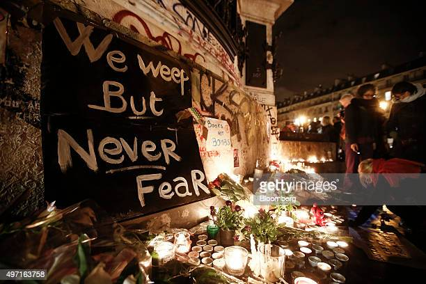 A sign that reads 'we weep but never fear' is displayed on the Place de la République in Paris France on Saturday Nov 14 2015 French President...