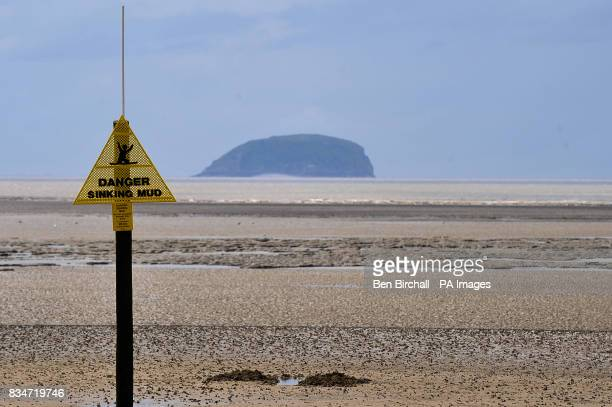 A sign that says 'Danger Sinking Mud' on WestonSuperMare beach