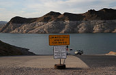 A sign warning boaters of low water levels is posted near the Echo Bay boat launch on May 12 2015 in Lake Mead National Recreation Area Nevada As...