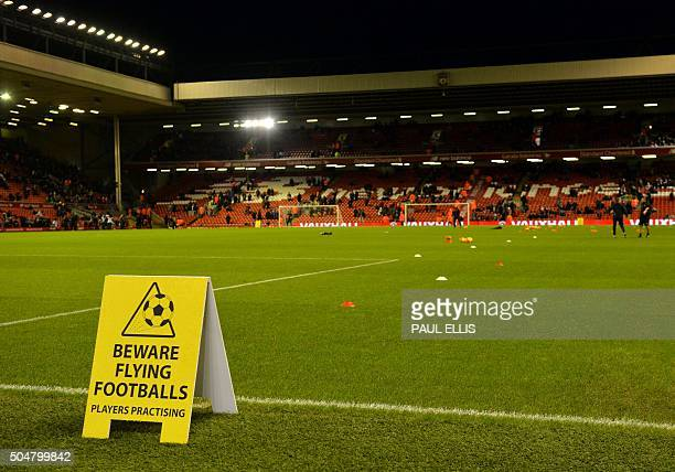 A sign warning fans of flying balls stands on the touchline before the English Premier League football match between Liverpool and Arsenal at Anfield...