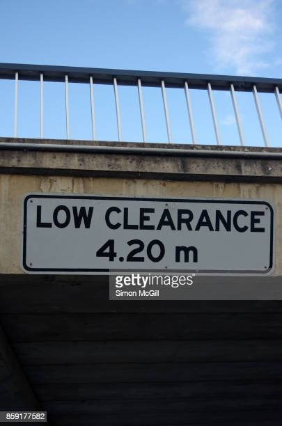 Sign warning of a low clearance height of 4.2 metres under the Parkes Way bridge over Wendouree Drive in Canberra, Australian Capital Territory, Australia