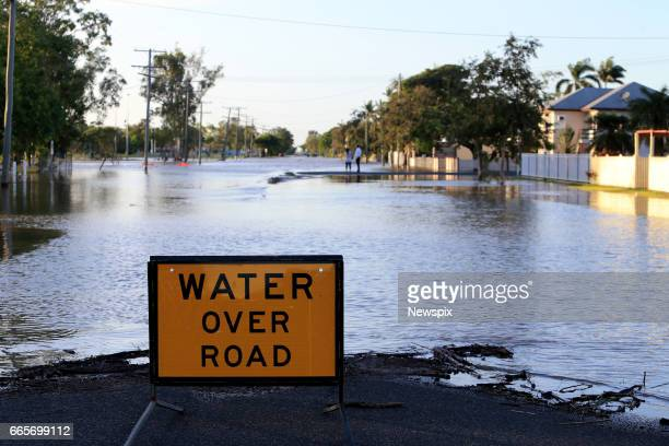 ROCKHAMPTON QLD A sign warning of floodwaters over the roads at Depot Hill in Rockhampton Queensland after the Fitzroy River burst its banks in the...