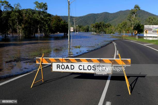 ROCKHAMPTON QLD A sign warning of floodwaters over the roads in Rockhampton Queensland after the Fitzroy River burst its banks in the aftermath of...