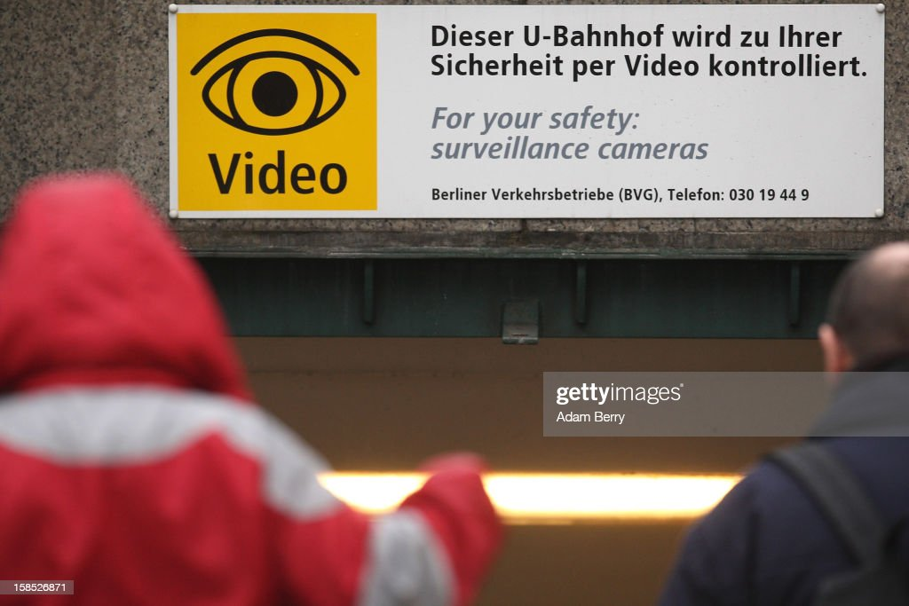 A sign warning of security cameras hangs at the entrance to a train station on December 18, 2012 in Berlin, Germany. After an attempted bombing at the main train station in Bonn, about whose planting on site security cameras were not able to provide sufficient footage as evidence, the German government is discussing increasing its public video surveillance.