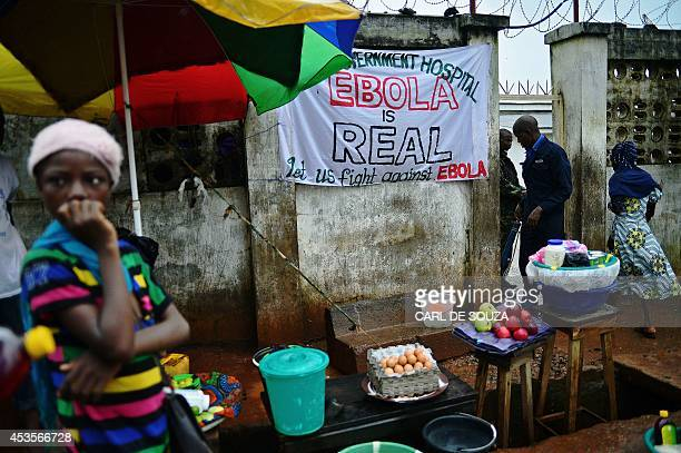 A sign warning of the dangers of ebola outside a government hospital in Freetown on August 13 2014 The World Health Organisation revealed that the...