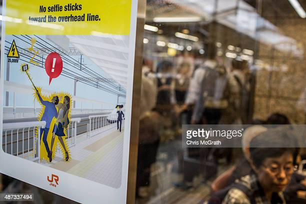 A sign warning people to be careful when using selfie sticks is seen at the Shinkansen platform at Kyoto Station on September 8 2015 in Kyoto Japan...