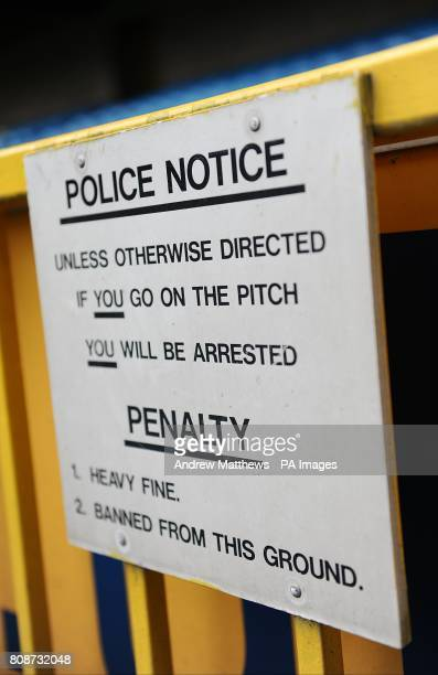 A sign warning people to stay off the pitch