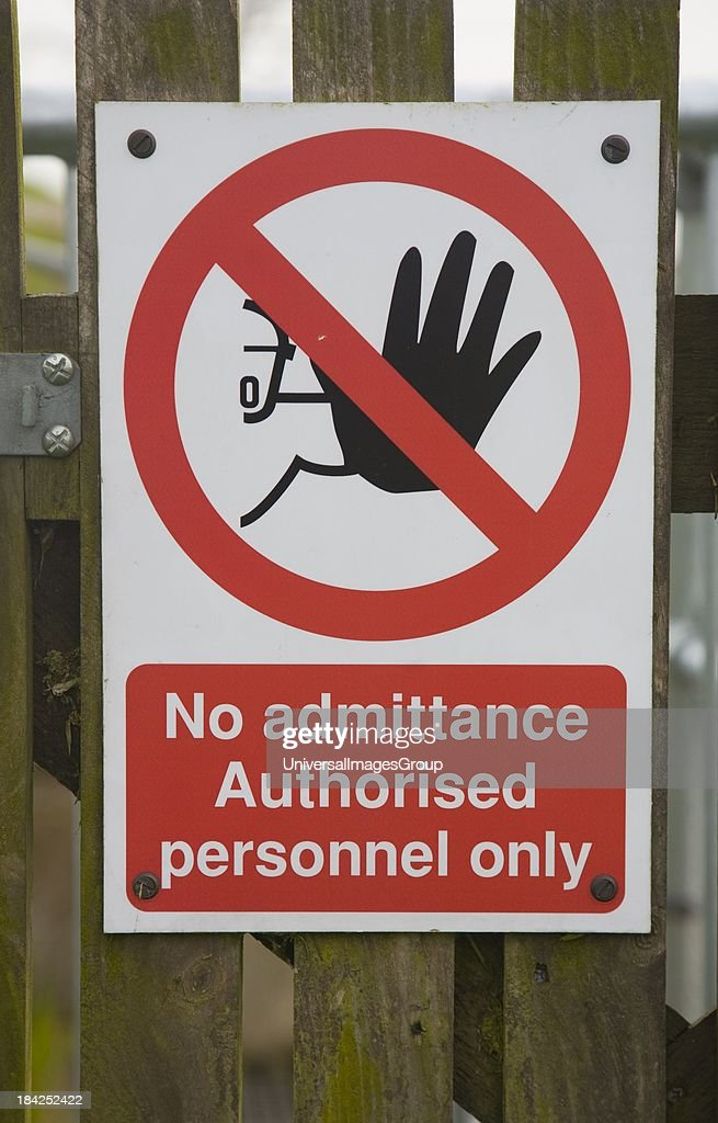 Sign warning that there is no admittance except to authorised personnel only UK