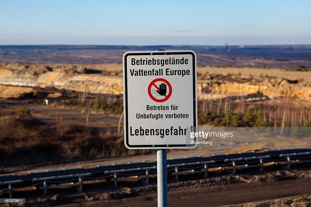 A sign warning trespassers stands at the open-pit lignite mine operated by Vattenfall AB in Welzow-Sued, Germany, on Saturday, Jan. 11, 2014. Across the continent's mining belt, from Germany to Poland and the Czech Republic, utilities such as Vattenfall AB, CEZ AS and PGE SA are expanding open-pit mines that produce lignite. Photographer: Krisztian Bocsi/Bloomberg via Getty Images