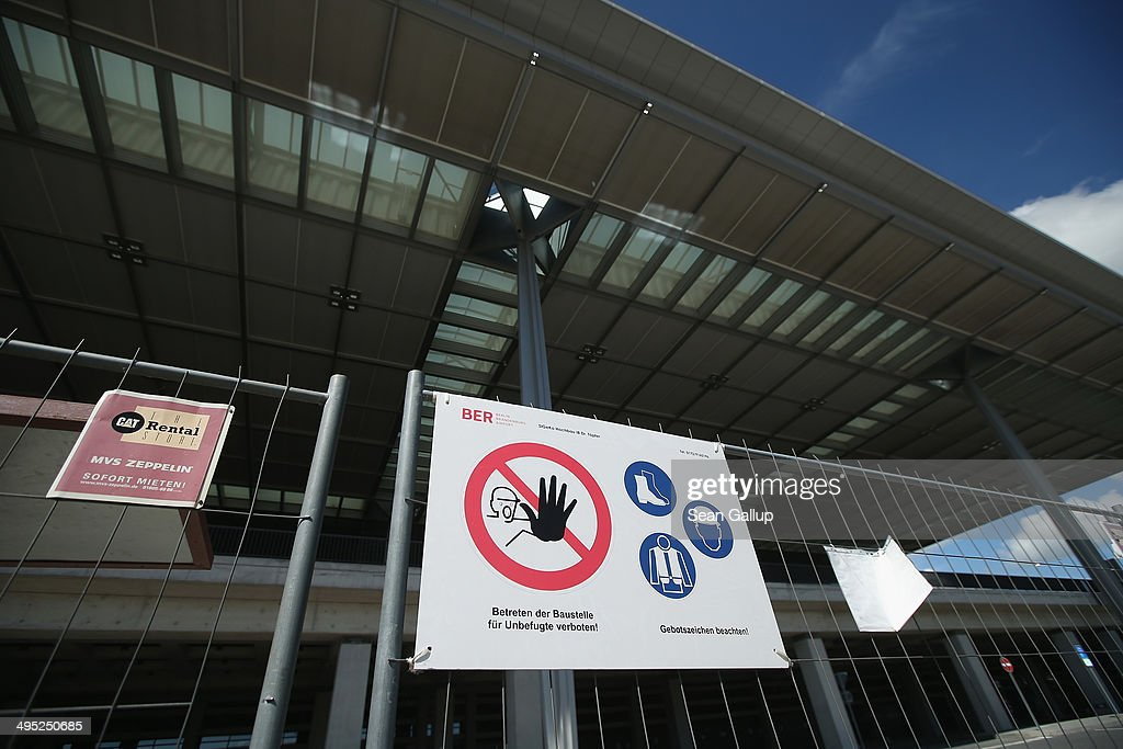 A sign warning unauthorized people not to enter hangs on a fence at a construction site at the main terminal at the unfinished new BER Willy Brandt Berlin Brandenburg International Airport on June 2, 2014 in Schoenefeld, Germany. The airport, which is years behind schedule with no opening date yet in sight, has now been hit by a corruption scandal involving head technician Jochen Grossmann, who is accused of demanding a EUR 500,000 bribe from a contracting firm. The airport's governing body is meeting today and has designated a task force to determine whether Grossmnn might have demanded bribes from other companies as well.