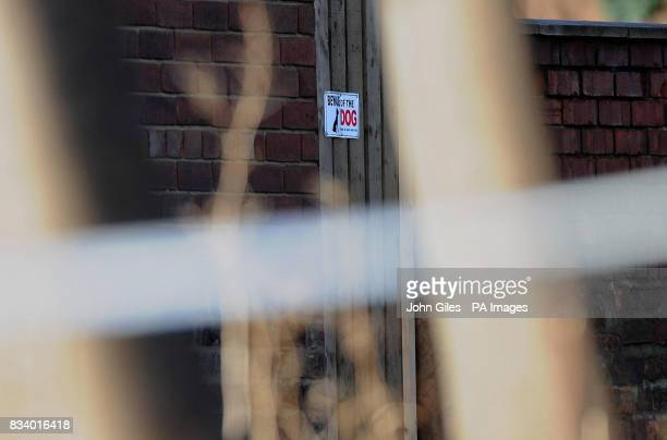 A sign warning visitors to Beware of the Dog is visible behind police tape at the house in Wakefield where one year old Archie Lee Hirst was killed...
