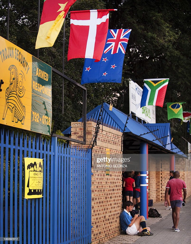A sign warns about 'armed response' over an electric fence at the entrance of the Hoërskool Randburg high school, where Brazil's national soccer tem will practice preparing to dispute the 2010 FIFA South Africa World Cup, on May 24th, 2010 in Johannesburg, South Africa.