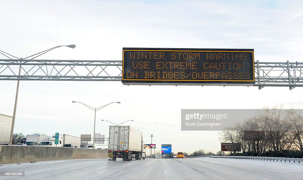 A sign warns of a winter storm along Interstate 75 in icy conditions January 29, 2014 in Atlanta, Georgia. Thousands of motorists were stranded, many overnight, as a winter storm dropped three inches of snow, and ice made driving hazardous.