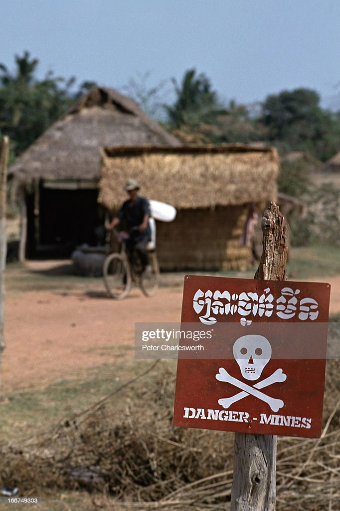 A sign warns of landmines that litter an area where former refugees have been repatriated from Thailand as part of the UNTAC the United Nations...