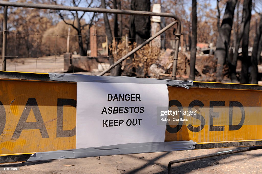 A sign warns of the dangers of asbestos at a burnt out property in the Wondong region on February 19 2009 in Wondong Australia Victoria Police have...