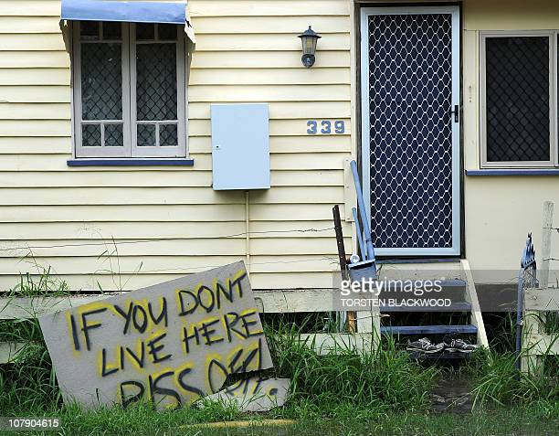 A sign warns off sightseers outside a floodbound home in Rockhampton on January 6 2011 Tens of thousands of people in Rockhampton braced for complete...