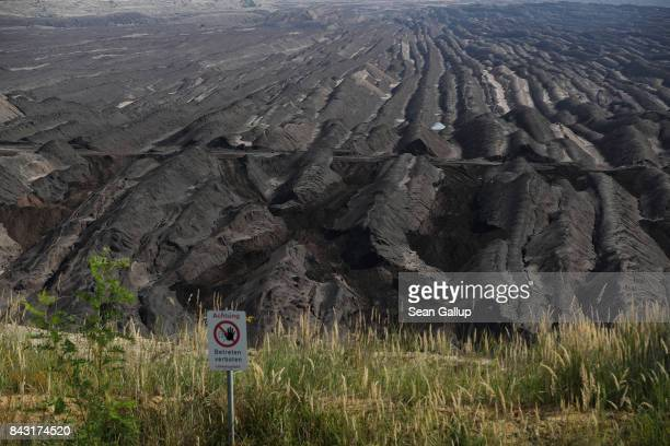 A sign warns visitors not to advance further on the edge of a rehewn moonscapelike portion of the Welzow Sued openpit lignite coal mine on September...