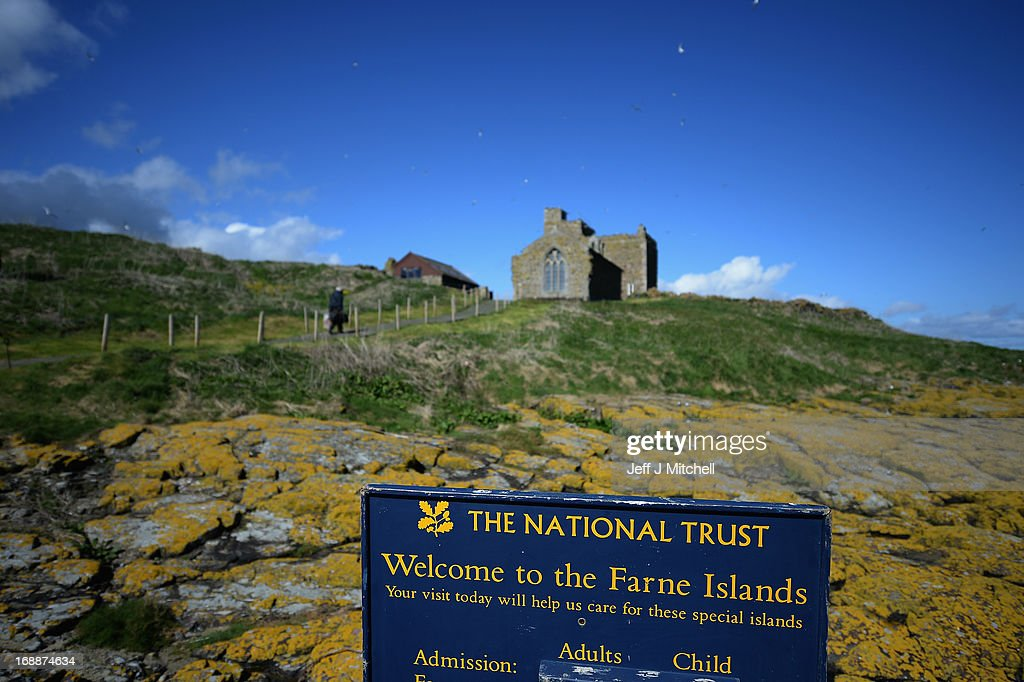 A sign welcomes members of the public to the Farne Islands where Puffins are returning to their summer breeding grounds on May 16 2013 in the Farne...