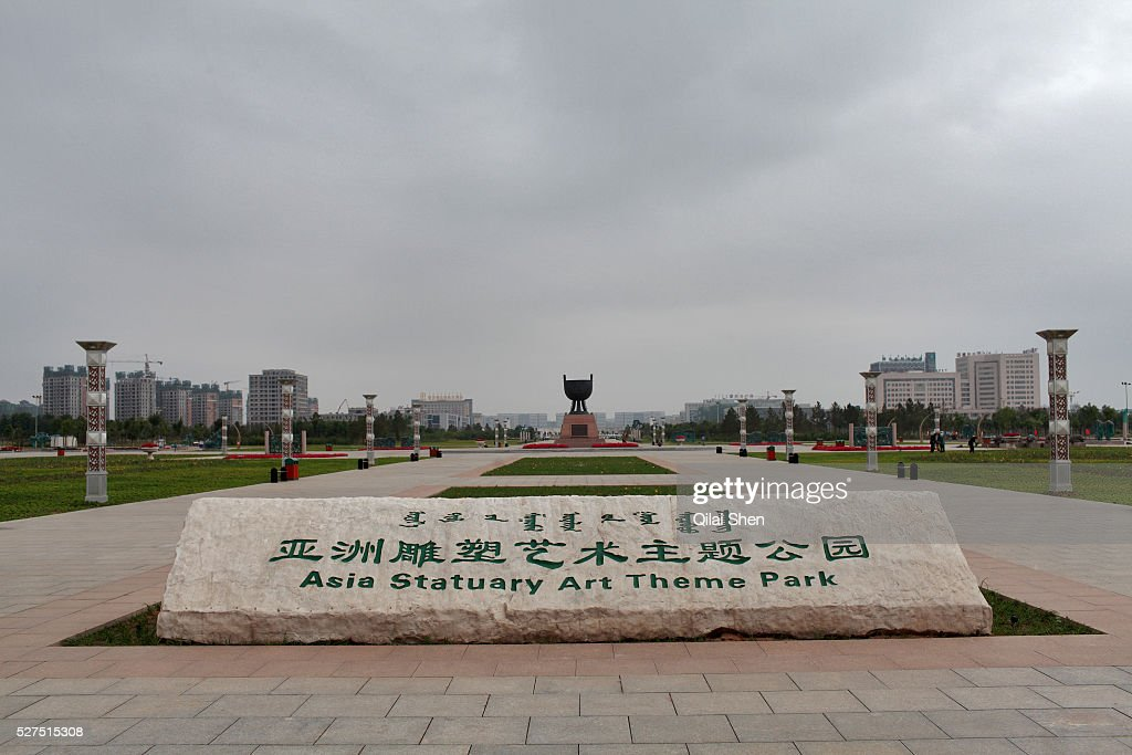 A sign welcomes visitors to the Asia Statutory Art Theme Park in Kangbashi New District of Ordos City Inner Mongolia China on 16 August 2011 With an...