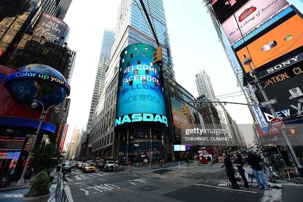 A sign welcoming Facebook is flashed on a screen outside the NASDAQ stock exchange at Times Square in New York May 18 2012 Facebook is set to go...