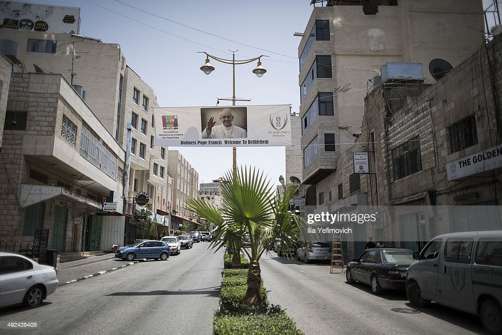 A sign welcoming Pope Francis hangs on the road to church of Nativity on May 20, 2014 in Bethlehem, West Bank. Pope Francis is due to make his first visit to the Holy Land as pontiff and will visit both the West Bank and Israel this coming Sunday. The Pope will celebrate two public Masses during his visit, one in Amman, Jordan and the other in Manger Square in Bethlehem.