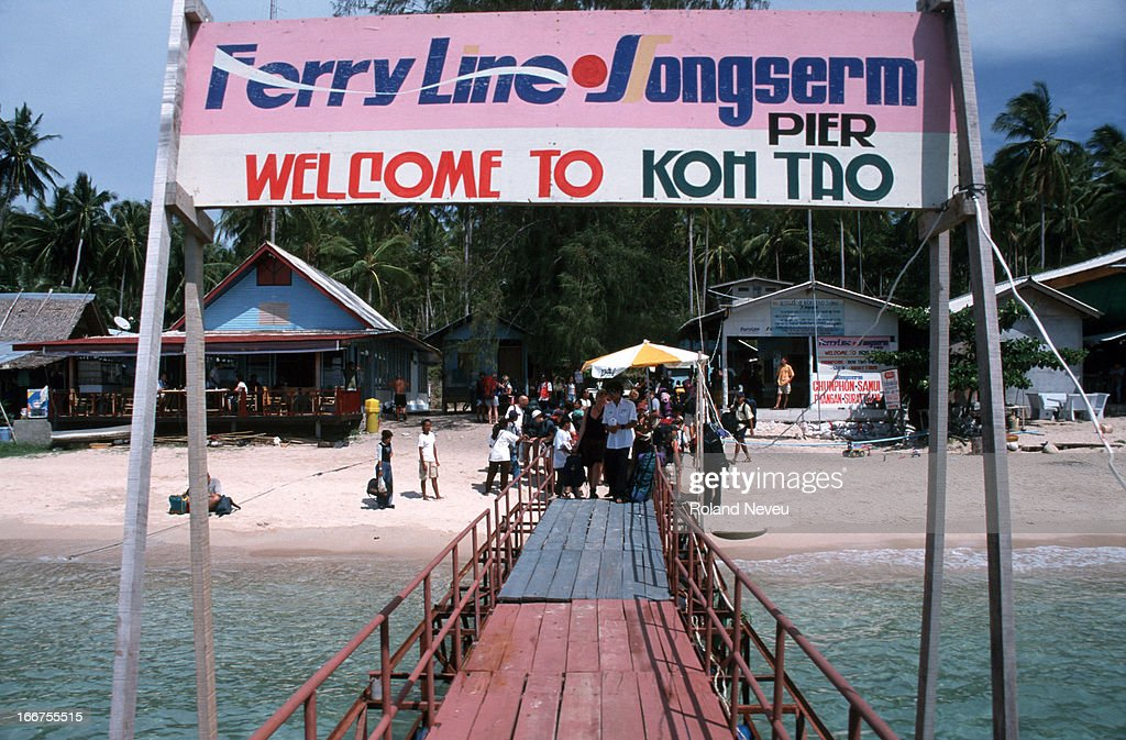A sign welcoming tourists over a boat landing in Koh Tao Island