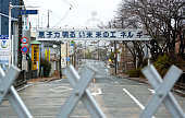 A sign which reads 'Nuclear Bright Future Energy' is seen at a nogo zone of crippled Fukushima Daiichi Nuclear Power Plant on March 9 2015 in Futaba...