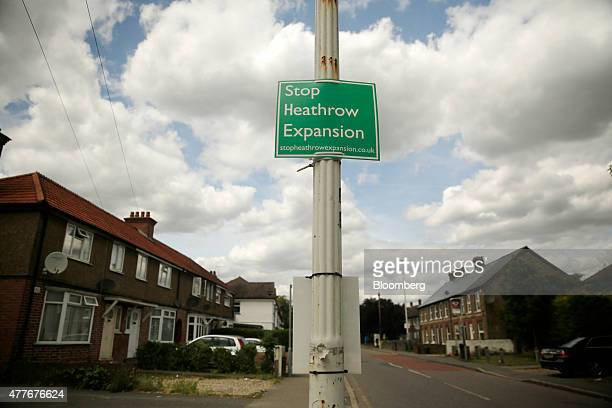 A sign which reads 'Stop Heathrow Expansion' sits on a street lamppost nearby rows of residential housing in the village of Sipson UK on Monday June...