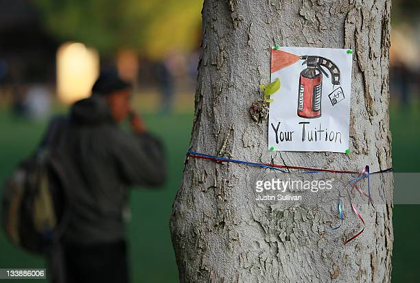 A sign with a picture of a pepper spray canister is posted on a tree during a demonstration at the UC Davis campus on November 21 2011 in Davis...