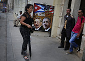 A sign with a picture of Cuban President Raul Castro and US President Barack Obama is seen on a wall in Old Havana as Cuba prepares for the visit of...