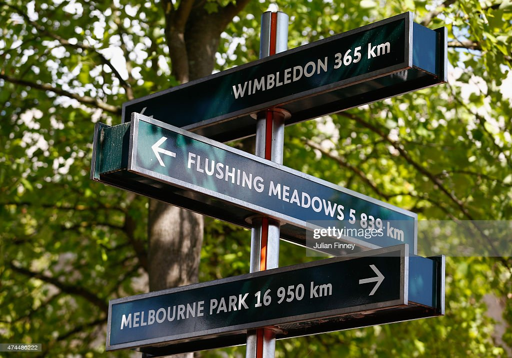 A sign with distance to global tennis venues is seen ahead of the 2015 French Open at Roland Garros on May 23, 2015 in Paris, France.