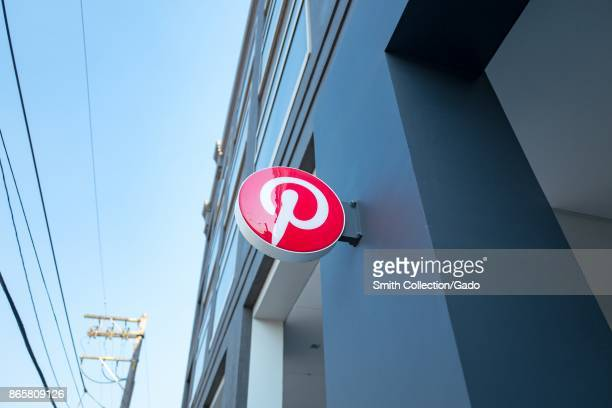 Sign with logo at headquarters of social media company Pinterest in the South of Market neighborhood of San Francisco California October 13 2017 SoMa...