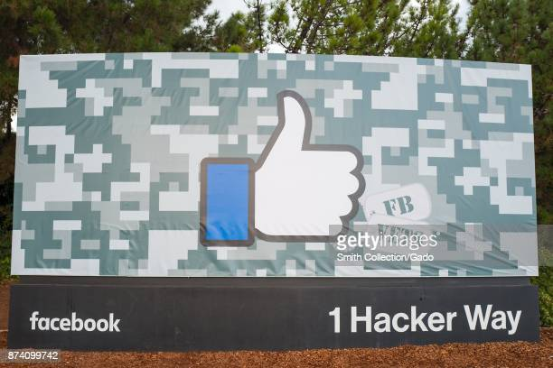 Sign with logo featuring the distinctive Thumbs Up symbol of Facebook decorated for Veterans Day at the headquarters of social network company...