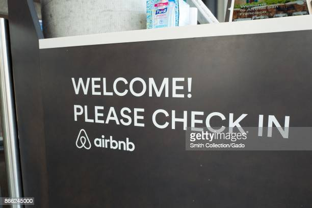 Sign with message reading 'Please Check In' at the headquarters of shortterm rental technology company Airbnb in the South of Market neighborhood of...