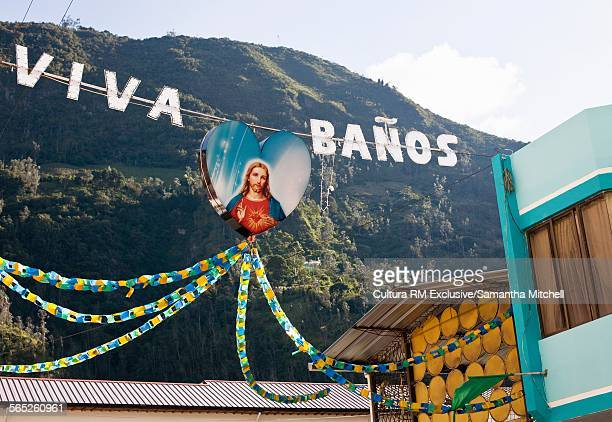 Sign with picture of Jesus Christ hanging in Banos, Ecuador