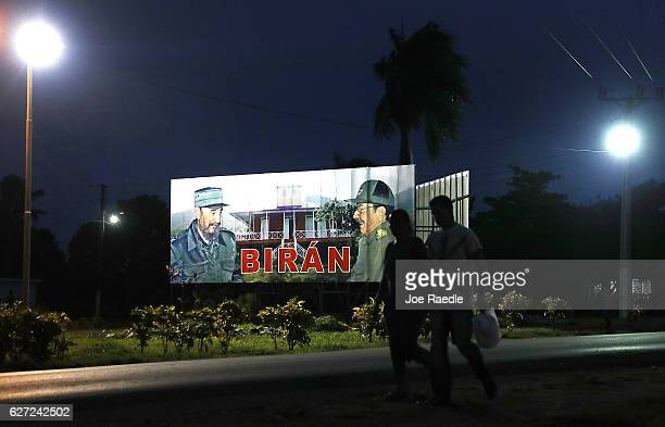 A sign with pictures of former Cuban President Fidel Castro and his brother current Cuban President Raul Castro marks the entrance to the home town...