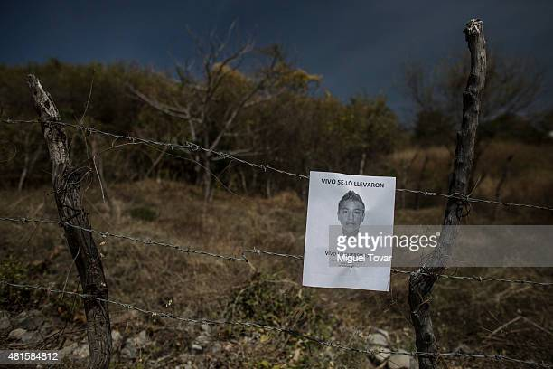 IGUALA MEXICO JANUARY 15 A sign with the face of Jesus Rodriguez Tlatempa one of the missing students from Ayotzinapa is seen attached on a fence at...