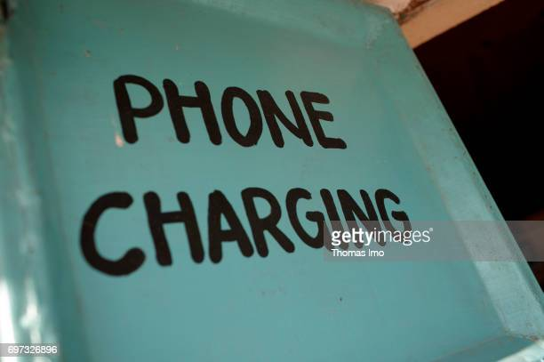 Sign with the inscription 'Phone Charging' in Kenya on May 17 2017 in Talek Kenya