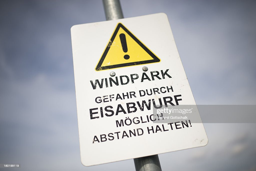 A sign with the inscription Windpark - danger of ice shedding - keep distance, is seen near the coast of the north sea on August 29, 2013 in Galmsbuell, Germany. Wind energy rises in german region of Schleswig-Holtstein.